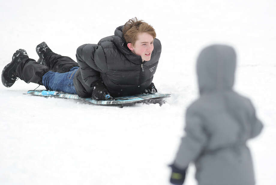 Sledding at Bruce Park in Greenwich, Friday, March 8, 2013. Photo: Bob Luckey / Greenwich Time