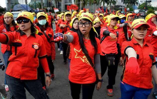 Indonesian women march during International Women's Day in Jakarta on March 8, 2013.  According to the United Nations, women of all continents can look back to a tradition that represents at least nine decades of struggle for equality, justice, peace and development.  Photo: Bay Ismoyo, AFP/Getty Images