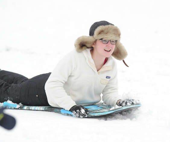 Grace King, 14, of Greenwich, enjoys sledding at Bruce Park in Greenwich, Friday, March 8, 2013. King said she goes to Masters School and had the day off due to the snow. Photo: Bob Luckey / Greenwich Time
