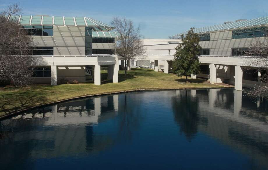 The ConocoPhillips campus is a series of low rise buildings surrounding lagoons and subtle landscaping.