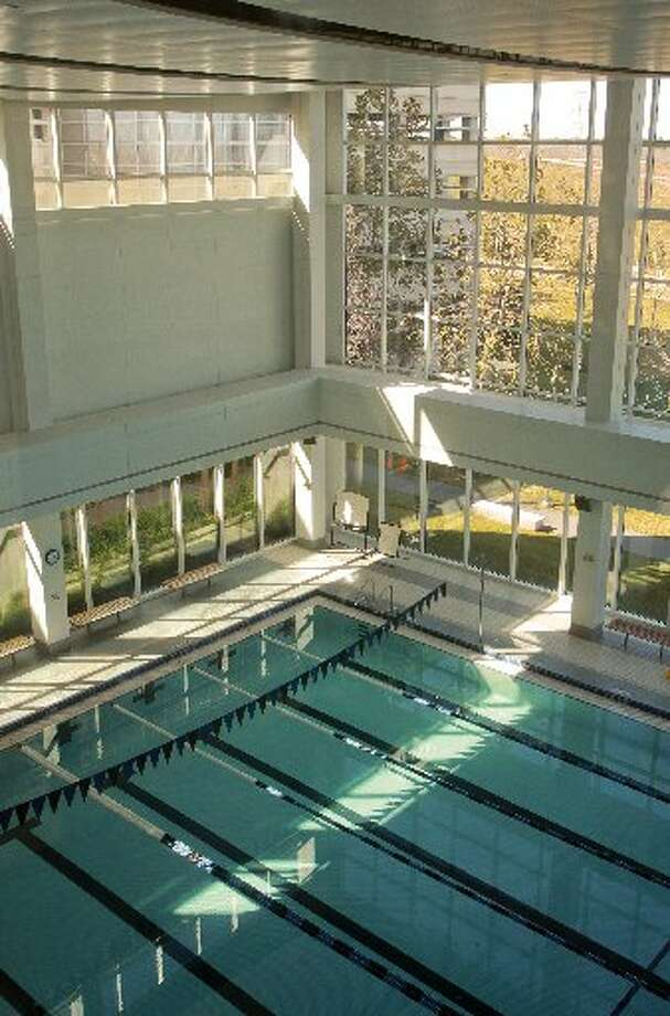 The swimming pool at ConocoPhillips overlooks a soccer field.