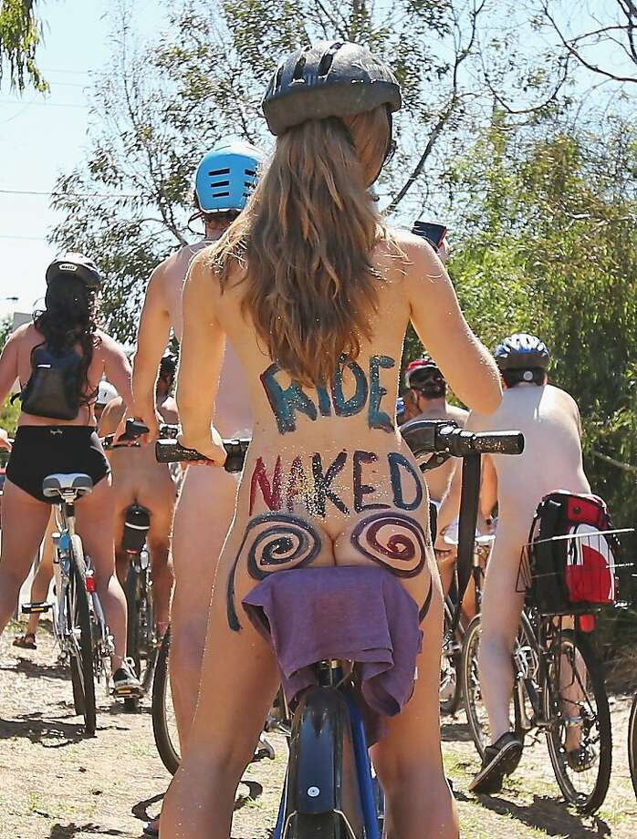 "Rear-view cheer: In Melbourne, Australia, cyclists pedal in their birthday suits during the World Naked Bike Ride. The two-wheel trek is intended to ""peacefully expose the vulnerability of cyclists, humanity and nature in the face of cars, aggression, consumerism and nonrenewable energy."" Not too mention chafing. Photo: Scott Barbour, Getty Images"