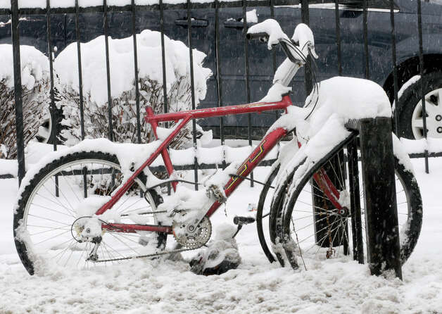 A bike is covered in snow along Madison Ave. near Lark St.  during a snow storm on Friday March 8, 2013 in Albany, N.Y. (Lori Van Buren / Times Union) Photo: Lori Van Buren