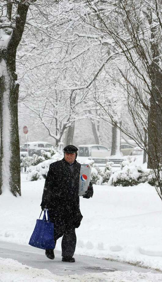 Carl Kopps makes his way to work as he walks through the snow on Eagle Street March 8, 2013, in Albany, N.Y.   (Skip Dickstein/Times Union) Photo: SKIP DICKSTEIN