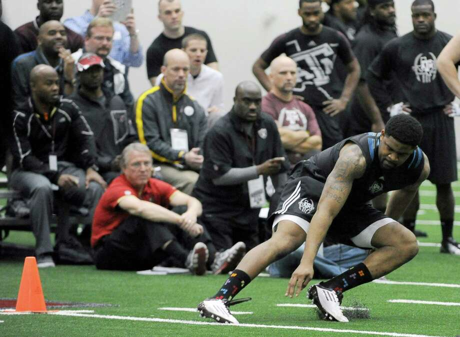 Texas A&M's Damontre Moore runs a drill for NFL scouts on NFL Pro Day, Friday, March 8, 2013 in College Station, Texas. (AP Photo/Pat Sullivan) Photo: Pat Sullivan, Associated Press / AP