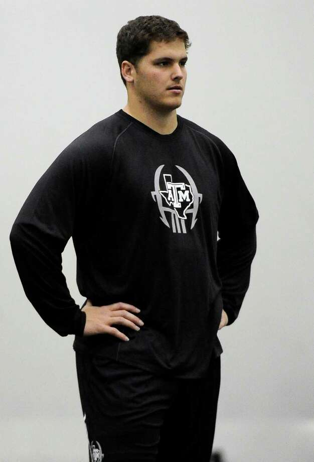 Texas A&M's Luke Joeckel waits his turn to work out for NFL scouts Friday, March 8, 2013 in College Station, Texas. Joeckel may be the top overall pick in April's NFL draft. (AP Photo/Pat Sullivan) Photo: Pat Sullivan, Associated Press / AP