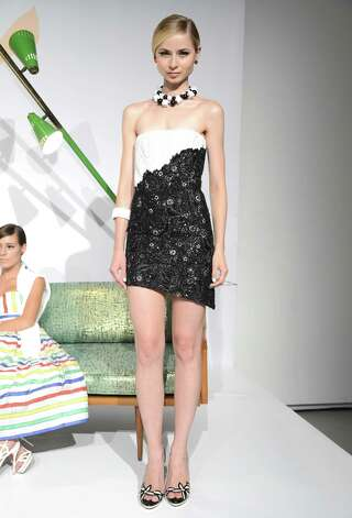 A model poses at Alice + Olivia By Stacey Bendet Spring 2013 Mercedes-Benz Fashion Week at Century 548 on September 10, 2012 in New York City.  Photo: Jason Kempin, Getty Images For Alice + Olivia / 2012 Getty Images