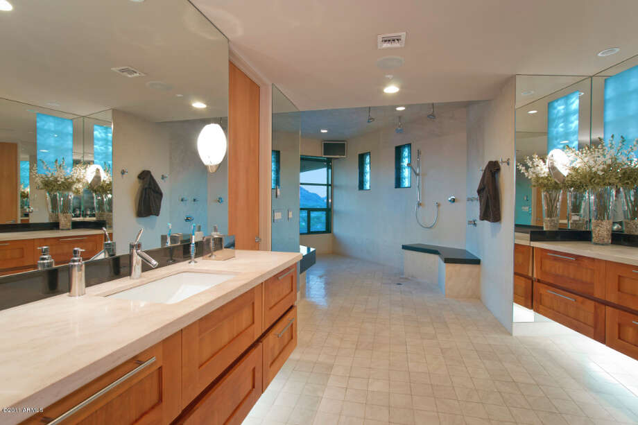 Master bath with double vanities and a huge shower room