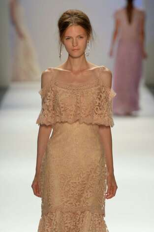 A model walks the runway at theTadashi Shoji Spring 2013 fashion show during Mercedes-Benz Fashion Week at The Stage at Lincoln Center on September 6, 2012 in New York City. Photo: Mike Coppola, Getty Images For Mercedes-Benz F / 2012 Getty Images