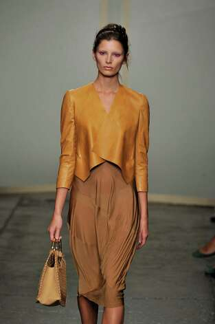 A model walks the runway at the Donna Karan Spring Summer 2013 fashion show during New York Fashion Week on September 10, 2012 in New York, United States. Photo: Chris Moore/Catwalking, Getty Images / 2012 Catwalking