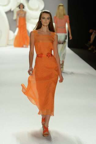 The Carolina Herrera  show offered this orange ode to spring femininity. Photo: Getty Images