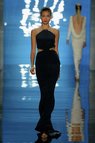A model walks the runway at the Reem Acra Spring 2013 fashion show during Mercedes-Benz Fashion Week at The Stage at Lincoln Center on September 10, 2012 in New York City. Photo: Frazer Harrison, Getty Images For Mercedes-Benz F / 2012 Getty Images