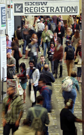 Crowds meander through the Austin Convention Center during South by Southwest Friday March 8, 2013 in Austin, TX. Photo: Edward A. Ornelas, San Antonio Express-News / © 2013 San Antonio Express-News