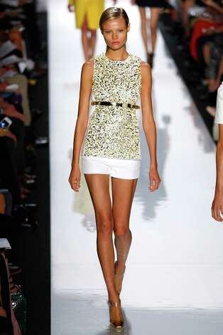 A model walks the runway during the Michael Kors show during Spring 2013 Mercedes-Benz Fashion Week at The Theatre Lincoln Center on September 12, 2012 in New York City. Photo: Edward James, WireImage / 2012 Edward James