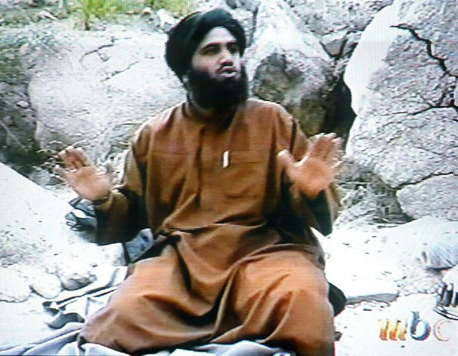 Sulaiman Abu Ghaith, Osama bin Laden's son-in-law and  al Qaeda spokesman, appears in a video broadcast in 2002. Photo: Ho, AFP/Getty Images
