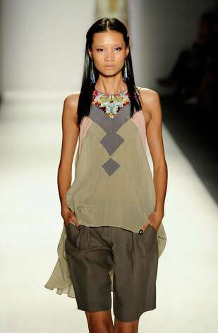 A model walks the runway at the Nicole Miller Spring 2013 fashion show during Mercedes-Benz Fashion Week at The Studio at Lincoln Center on September 7, 2012 in New York City. Photo: Fernanda Calfat, Getty Images For Mercedes-Benz F / 2012 Getty Images
