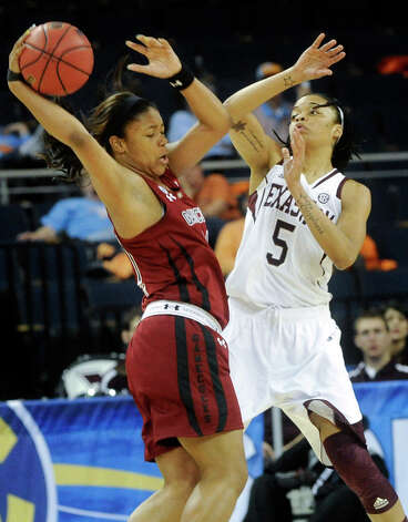 South Carolina forward Ashley Bruner, left, is defended by Texas A&M forward Kristi Bellock (5) during the second half of a NCAA college basketball game in the Southeastern Conference tournament, Friday, March 8, 2013, in Duluth, Ga. (AP Photo/John Amis) Photo: John Amis, Associated Press / FR69715 AP