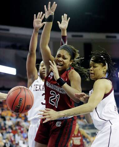 South Carolina forward Ashley Bruner (21) is covered by Texas A&M forward Kristi Bellock, right, as she loses the ball during the first half of their NCAA college basketball game in the Southeastern Conference tournament, Friday, March 8, 2013, in Duluth, Ga. (AP Photo/John Bazemore) Photo: John Bazemore, Associated Press / AP