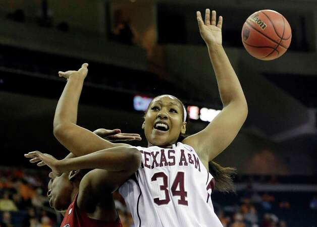 Texas A&M center Karla Gilbert (34) and South Carolina forward Elem Ibiam (33) battle for a rebound during the first half of an NCAA college basketball game at the Southeastern Conference tournament, Friday, March 8, 2013, in Duluth, Ga. (AP Photo/John Bazemore) Photo: John Bazemore, Associated Press / AP