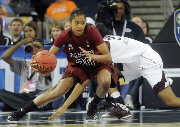 South Carolina guard Sancheon White (20) keeps the ball from Texas A&M center Rachel Mitchell (23) during the second half of an NCAA college basketball game at the Southeastern Conference tournament, Friday, March 8, 2013, in Duluth, Ga. (AP Photo/John Amis) Photo: John Amis, Associated Press / FR69715 AP