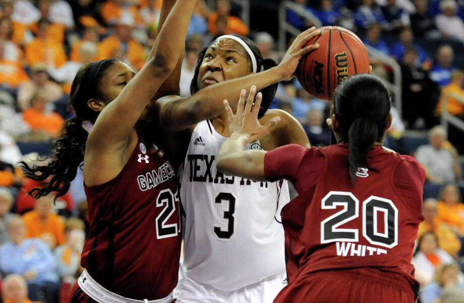 Texas A&M center Kelsey Bone (3) is defended by South Carolina forward Ashley Bruner (21), and guard Sancheon White (20) during the second half of an NCAA college basketball game at the Southeastern Conference tournament, Friday, March 8, 2013, in Duluth, Ga. (AP Photo/John Amis) Photo: John Amis, Associated Press / FR69715 AP