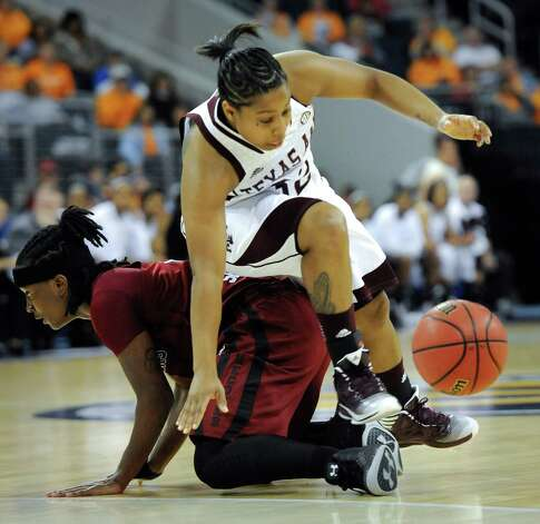 Texas A&M guard Adrienne Pratcher (32) goes over the back of South Carolina guard Khadijah Sessions (5) as they vie for the ball during the second half of an NCAA college basketball game at the Southeastern Conference tournament, Friday, March 8, 2013, in Duluth, Ga. (AP Photo/John Amis) Photo: John Amis, Associated Press / FR69715 AP