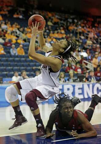 Texas A&M forward Kristi Bellock, left, is fouled by South Carolina forward Aleighsa Welch while going up for a shot during the second half of their NCAA college basketball game in the Southeastern Conference tournament on Friday, March 8, 2013, in Duluth, Ga. Texas A&M won 61-52. (AP Photo/John Bazemore) Photo: John Bazemore, Associated Press / AP