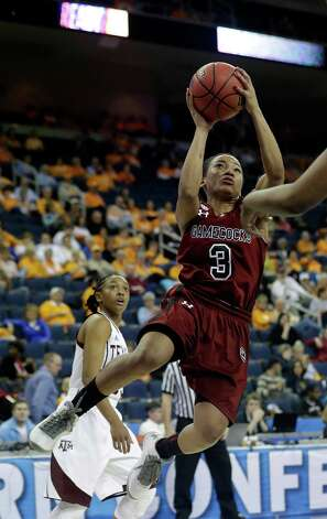 South Carolina's Ieashia Walker goes up for a shot during the first half of their NCAA college basketball game against the Texas A&M in the Southeastern Conference tournament, Friday, March 8, 2013, in Duluth, Ga. (AP Photo/John Bazemore) Photo: John Bazemore, Associated Press / AP