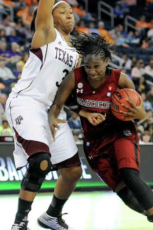 South Carolina forward Aleighsa Welch (24) drives against Texas A&M center Karla Gilbert (34) during the second half of a NCAA college basketball game in the Southeastern Conference tournament, Friday, March 8, 2013, in Duluth, Ga. Texas A&M won 61-52. (AP Photo/John Amis) Photo: John Amis, Associated Press / FR69715 AP