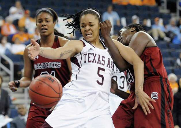 Texas A&M forward Kristi Bellock (5)works against South Carolina forward Ashley Bruner, left, and forward Aleighsa Welch for the ball during the second half of an NCAA college basketball game in the Southeastern Conference women's tournament, Friday, March 8, 2013, in Duluth, Ga. Texas A&M won 61-52. (AP Photo/John Amis) Photo: John Amis, Associated Press / FR69715 AP