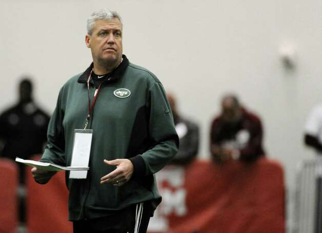 New York Jets coach Rex Ryan looks at draft prospects during workouts at Texas A&M's pro day Friday, March 8, 2013 in College Station, Texas. (AP Photo/Pat Sullivan) Photo: Pat Sullivan, Associated Press / AP