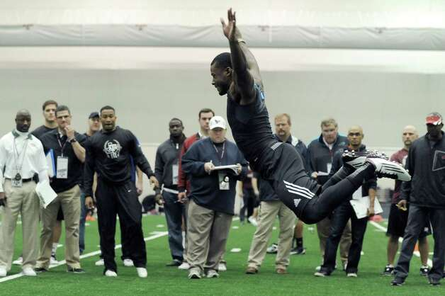 Texas A&M's Steven Campbell flies through the long jump for NFL scouts at pro day Friday, March 8, 2013 in College Station, Texas. (AP Photo/Pat Sullivan) Photo: Pat Sullivan, Associated Press / AP