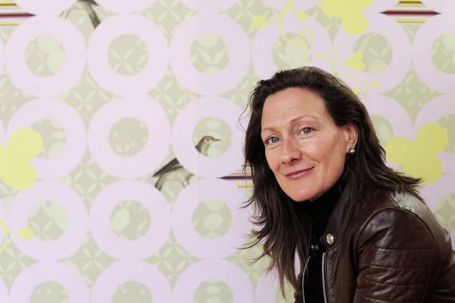 Sarah Rowland shows the custom wallpaper she designed for Dixie Donuts in Richmond, Va. Photo: Associated Press