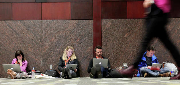 People attending South by Southwest work on their electronic devices at the Austin Convention Center Friday March 8, 2013 in Austin, TX. Photo: Edward A. Ornelas, San Antonio Express-News / © 2013 San Antonio Express-News