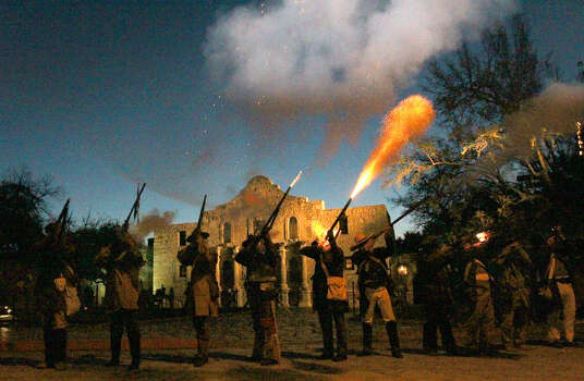 "Members of the San Antonio Living History Association fire muskets in front of the Alamo during the ""Dawn at the Alamo"" ceremony. One E-N reader responds to a story about the presence of the U.S. Army in San Antonio before the Battle at the Alamo. Photo: John Davenport / San Antonio Express-News"