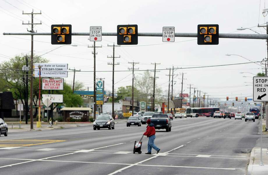 Councilman Cris Medina collaborated with the City's Department of Public Works and the Texas Department of Transportation to fund and install a Pedestrian Hybrid Beacon at the 2800 block of Fredericksburg Rd. The Pedestrian Hybrid Beacon, also known as High-Intensity Activated crossWalK (HAWK), is activated by a pedestrian and utilizes yellow and red lights to warn drivers when a pedestrian is crossing the roadway. Photo: Helen L. Montoya, San Antonio Express-News / ©2013 San Antonio Express-News