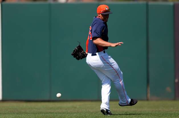 Astros outfielder George Springer loses a fly ball in the sun during the third inning. Photo: Evan Vucci