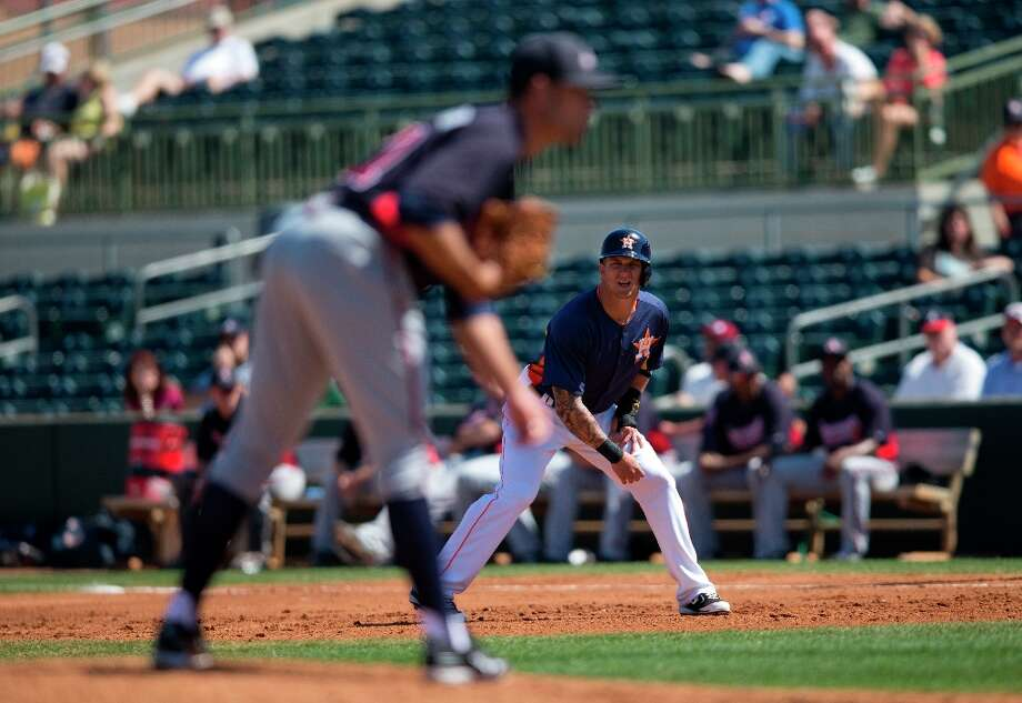 Brandon Barnes takes a lead off first base as Braves starting pitcher Sean Gilmartin gets ready to deliver a pitch during the first inning. Photo: Evan Vucci