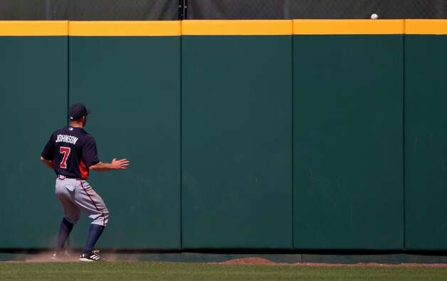 Braves outfielder Reed Johnson watches as a ball hit by Brandon Barnes clears the fence during the third inning. Photo: Evan Vucci