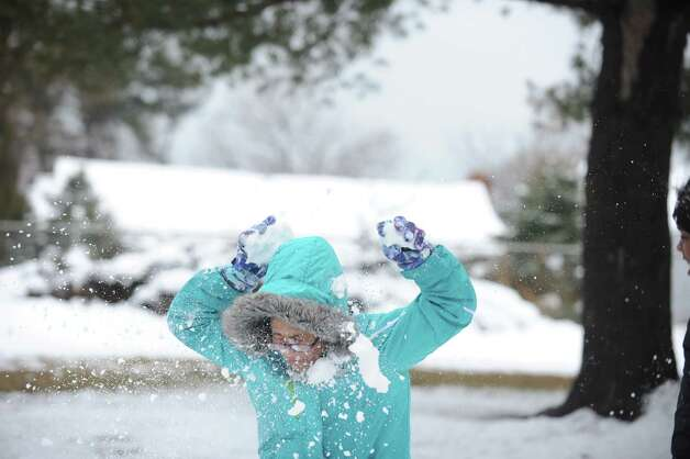 Thirteen-year-old Akyah Valera is pummelled during a snowball fight with friends in Bridgeport, Conn. Friday, Mar. 8, 2013. Photo: Autumn Driscoll