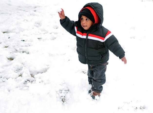 Twenty-one-month-old Adan Jeffreys throws a snowball at his cousin while playing outside in Bridgeport, Conn. Friday, Mar. 8, 2013. Photo: Autumn Driscoll