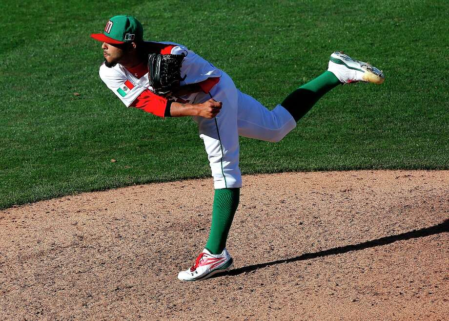 Mexico's Sergio Romo pitches against Italy during the ninth inning of a World Baseball Classic baseball game, Thursday, March 7, 2013, at Salt River Fields in Scottsdale, Ariz. Italy won 6-5. Photo: Matt York, Associated Press / AP