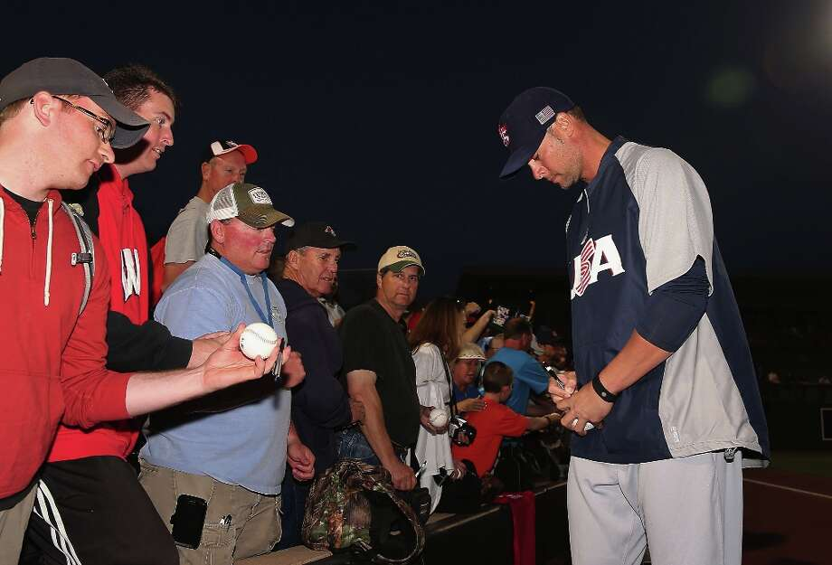 Pitcher Ryan Vogelsong of Team USA signs autographs for fans before the spring training game against the Colorado Rockies at Salt River Fields at Talking Stick on March 6, 2013 in Scottsdale, Arizona. Photo: Christian Petersen, Getty Images / 2013 Getty Images