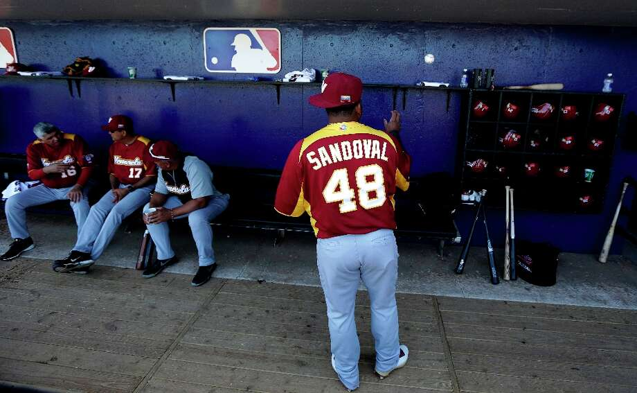 Venezuela infielder Pablo Sandoval tosses a baseball against the wall of the dugout before an exhibition baseball game against the New York Mets, Wednesday, March 6, 2013, in Port St. Lucie, Fla. Photo: Julio Cortez, Associated Press / AP