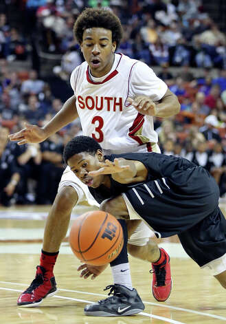 Steele's Teyvon Lundy and South Grand Prairie's Mark Howell grab for a loose ball during first half action of their Class 5A state semifinal game Friday March 8, 2013 at the Frank Erwin Center in Austin, Tx. Photo: Edward A. Ornelas, Edward A. Ornelas / San Antonio Express-News / © 2013 San Antonio Express-News