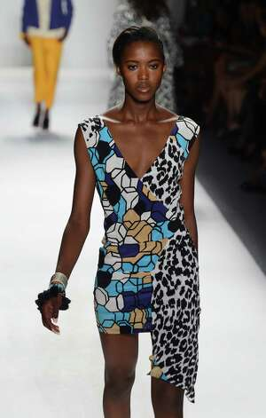 A model walks the runway at the Tracy Reese Spring 2013 fashion show for TRESemme during Mercedes-Benz Fashion Week at The Studio at Lincoln Center on September 9, 2012 in New York City. Photo: Frazer Harrison, Getty Images For TRESemme / 2012 Getty Images