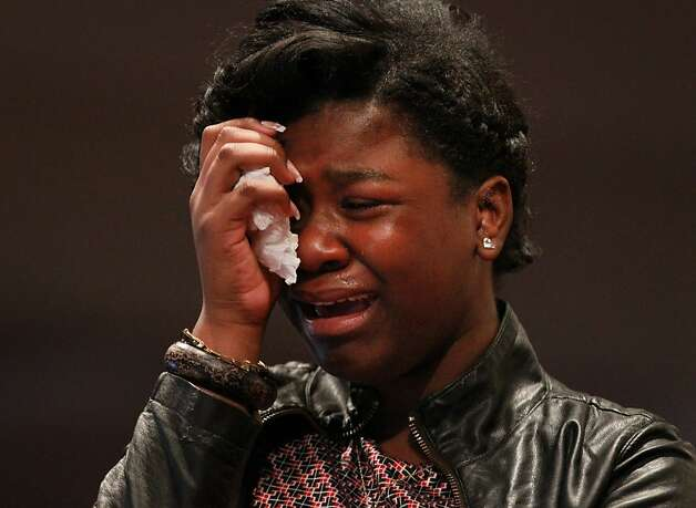 A friend of Hadari Kanbom Askari, 15, cries during his funeral on  Saturday, August 4, 2012, at Love Center Ministries in Oakland.  Askari had just earned his first paycheck as an summer intern for the Oakland Fire Department when he was shot and killed July 10, 2012, outside of his home in Oakland. Photo: Lacy Atkins, The Chronicle