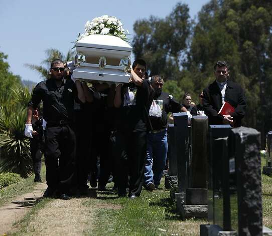Family and friends carry the casket of Alejandro Aguilera, 18,  through the Chapel of the Chimes Memorial Park, Thursday June 14, 2012, in Hayward. Aguilera was killed in a drive-by shooting as he was entering a market in Oakland. Photo: Lacy Atkins, The Chronicle
