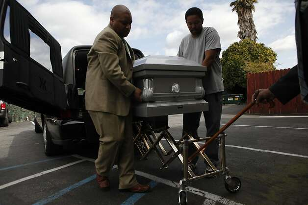 Ramon Price, Sr., right, helps Antoine Miller carry his son's casket into the Whitted-Atkins Funeral Home to prepare him for the family viewing. Price, 17, was one of the 131 homicide victims of 2012. Photo: Lacy Atkins, The Chronicle