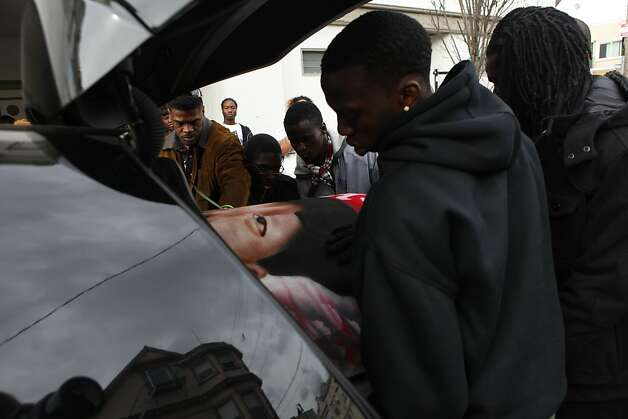 Pallbearers slide Lamont Price's casket into the hearse Wednesday, February 29, 2012, after his funeral at the Mount Calvary Baptist Church in Oakland. Lamont, 17, was shot and killed on Feb. 16, 2012 in east Oakland and no one has been arrested for his murder over a year later. Photo: Lacy Atkins, The Chronicle